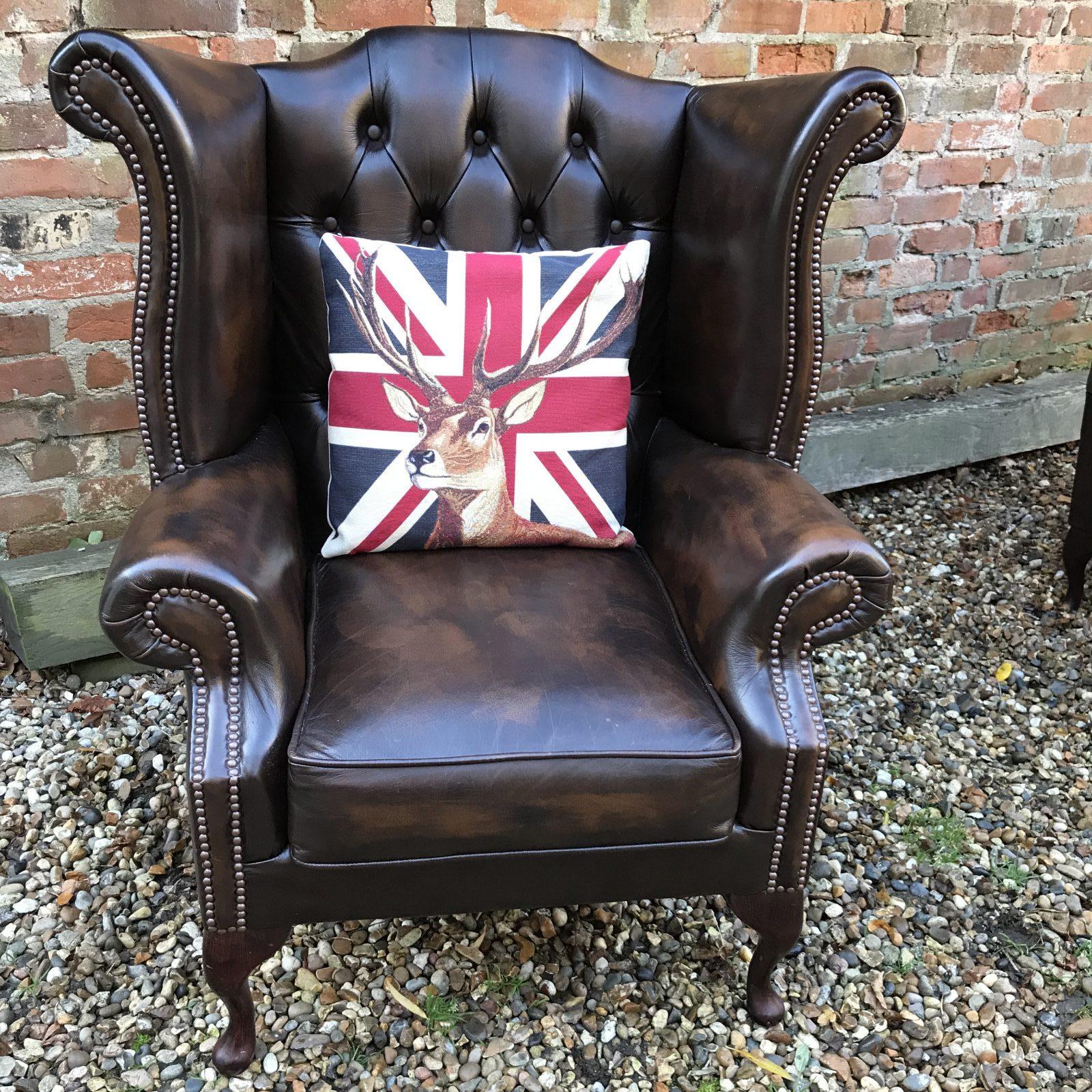 Dark Brown Wing Back Armchair.