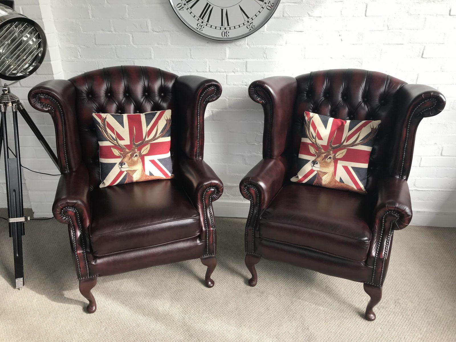Pair Of Matching Thomas Lloyd Wingback Chairs.