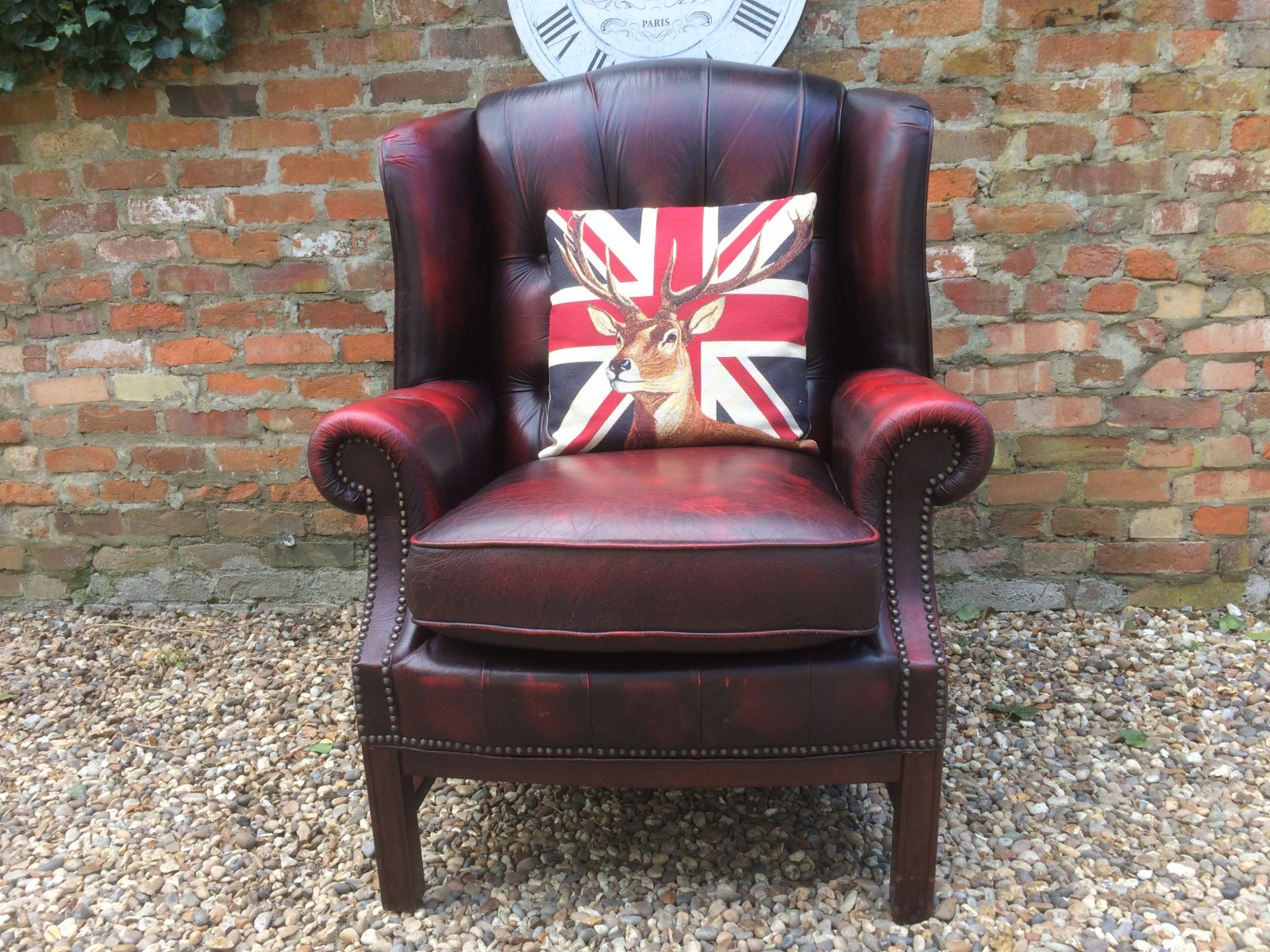 Classic Oxblood Wingback Armchair.
