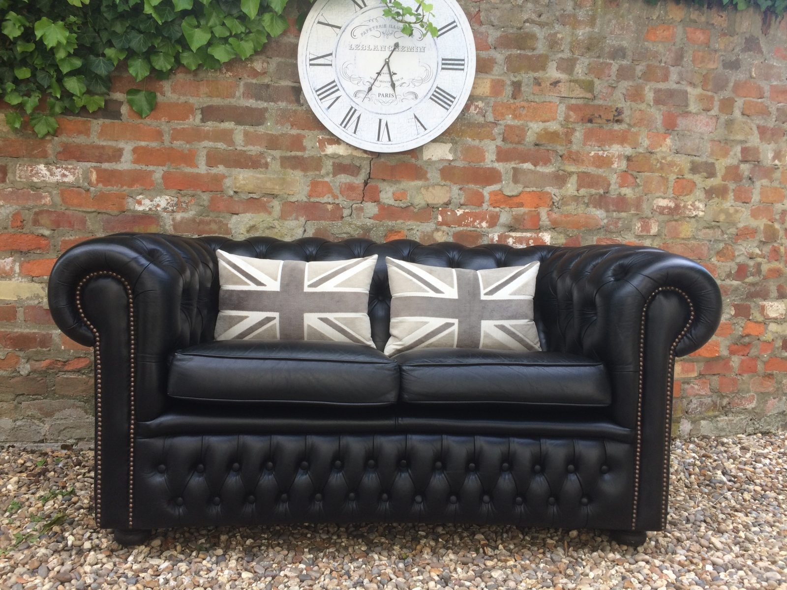 Charming Rich Black Chesterfield Sofa.